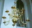 Kroonlühter kaheteistkümne tulega. 19. saj. (messing) Foto: L.Krigoltoi, 2001