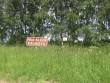 Kuuksi kalmistu. Pruun infotahvel oli alla kukkunud. Foto: Viktor Lõhmus, 10.06.2010.