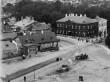 Elamu Vabaduse väljak 7 äriruumidega, 1929-1932.a. (arhiivifoto hoone asukohast enne ehitamist)