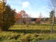 Vaade kalmistualale maanteelt jõe poole. Foto: Ulla Kadakas, 25.10.2005.